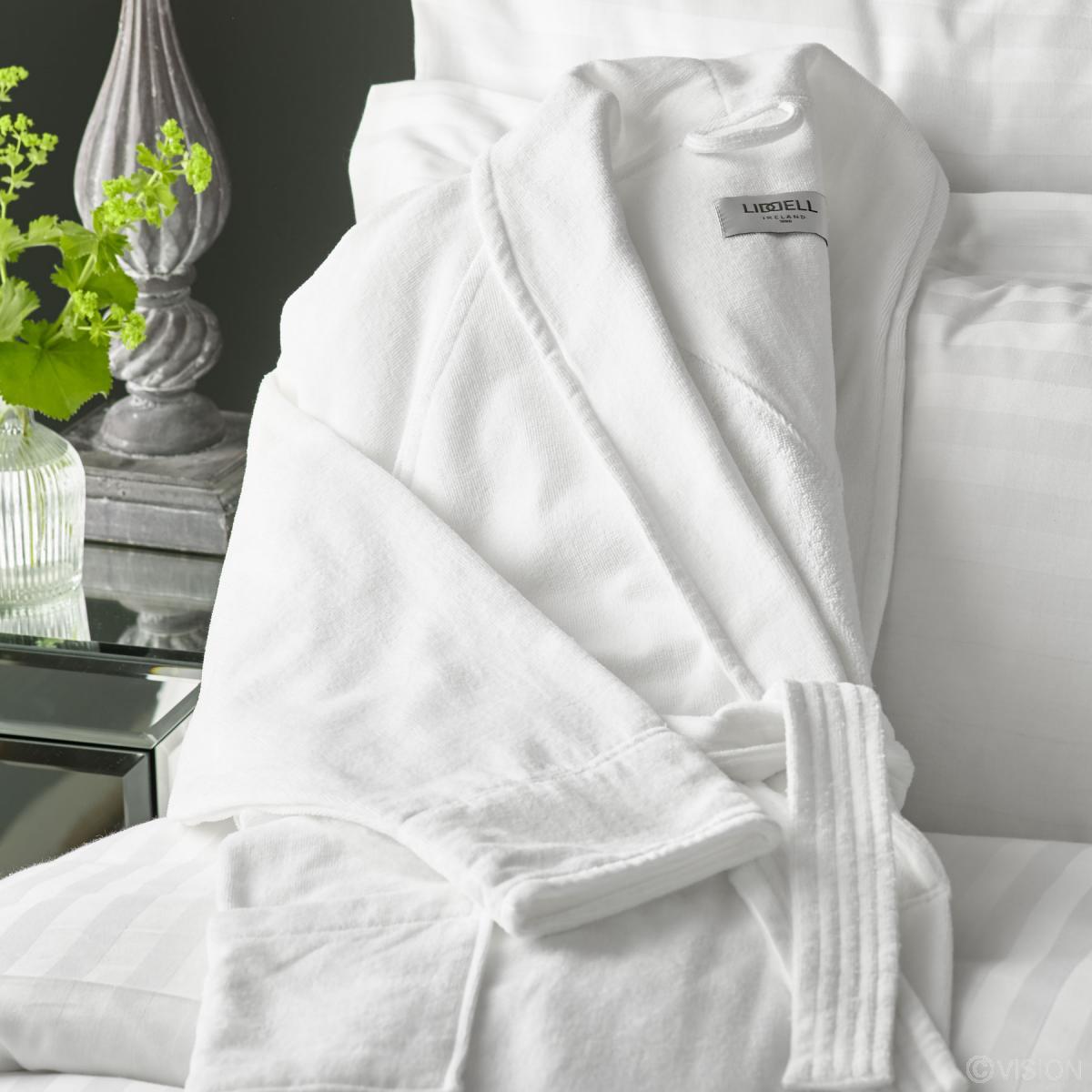 ca25aae996 Vermont white luxury bathrobe draped on bed